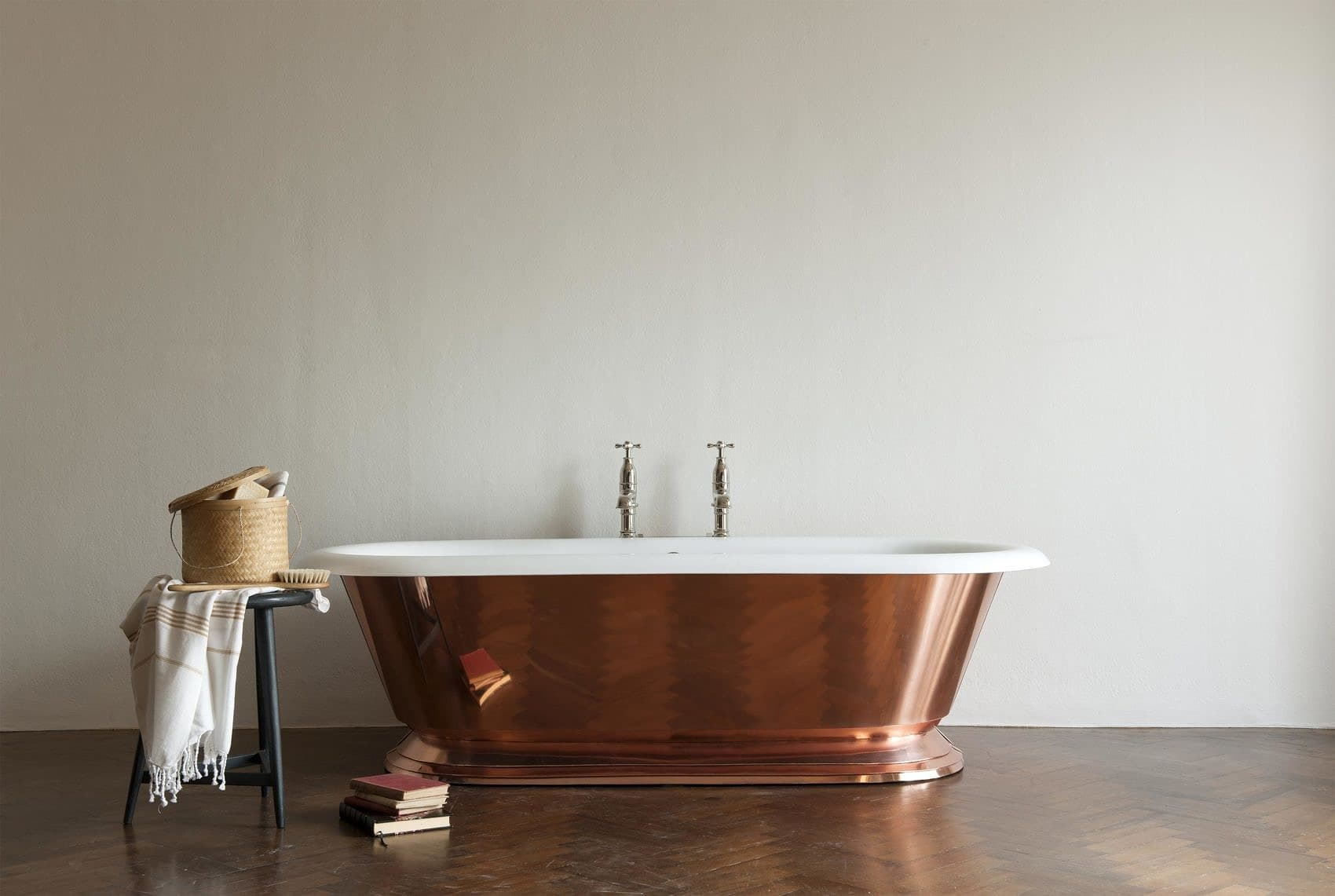 The Copper Tay cast iron skirted bath tub
